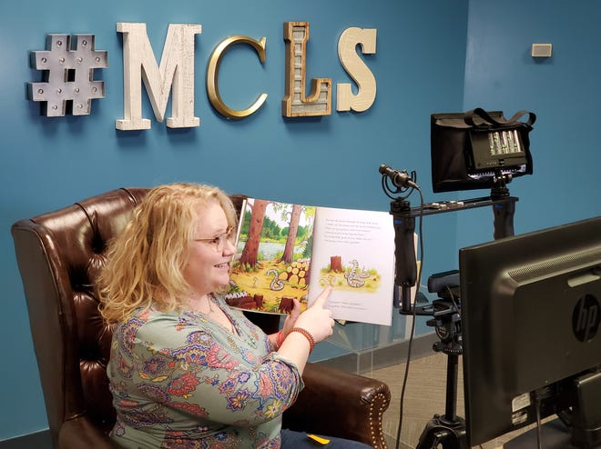 Katie Merritt, Youth Services Assistant Librarian, reads a book during an online storytime. The Muskingum County Library System has a number of digital offerings, and has expanded them since the start of the COVID-19 pandemic.