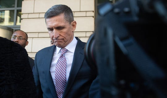 Former National Security Advisor Michael Flynn leaves U.S. District court in December 2018 after his sentencing hearing was delayed.