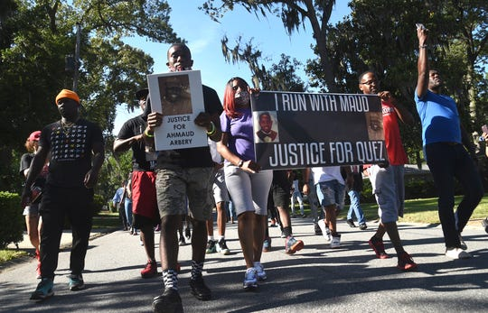 A crowd marches through a neighborhood in Brunswick, Ga on May 5, 2020. They were demanding answers in the death of Ahmaud Arbery.