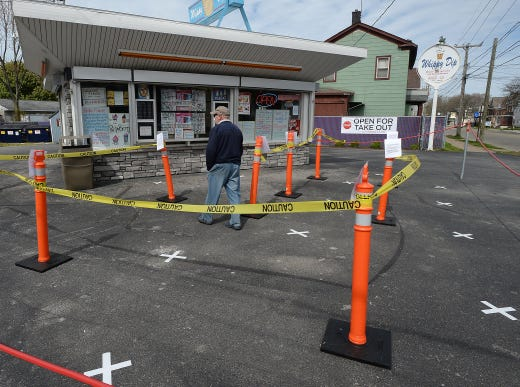 No need for social distancing on this day at the Whippy Dip ice cream stand in Erie, Pa. on May 5, 2020. Ed Beck, center, walks across the white X's placed six feet apart to help customers practice social distancing due to the COVID-19 coronavirus pandemic.