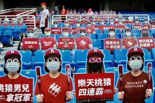 Life-size cutouts depicting a crowd of spectators are seen placed in empty seating during a Chinese Professional Baseball League (CPBL) game between the Rakuten Monkeys and CTBC Brothers at the Taoyuan Baseball Stadium on May 2, 2020, amid the COVID-19 coronavirus pandemic.  Global fans starved of baseball are flocking to Taiwan's league as the island basks in the glow of being one of the few places in the world hosting live sports.
