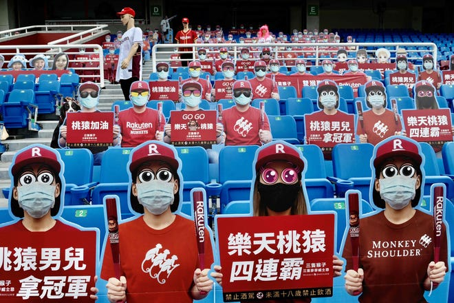 Life-size cutouts depicting a crowd of spectators are seen placed in empty seating during a Chinese Professional Baseball League game between the Rakuten Monkeys and CTBC Brothers at the Taoyuan Baseball Stadium in this May 2 file photo amid the COVID-19 coronavirus pandemic.