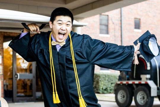 Hardin-Simmons University graduate Jesper Jiang celebrates graduation on the Hardin-Simmons University campus this spring despite no formal ceremony due to the COVID-19 pandemic. HSU President Eric Bruntmyer canceled commencement in March, saying graduates would be welcomed to cross the stage in December or next May.
