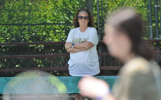Abilene High tennis coach Stacy Bryan watches her daughter McKenna practice during a private tennis lesson Thursday at Rose Park Tennis Center.