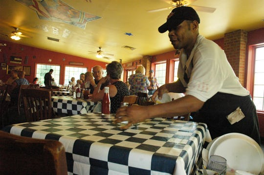 """Gardner """"Super Smitty"""" Smith was known as """"the worlds fastest busser"""" at Fuddrucker's in Asheville, with a time of under 15 seconds for clearing and cleaning a four-top. The Fuddrucker's closed permanently March 31, 2020 after a 34-year run."""
