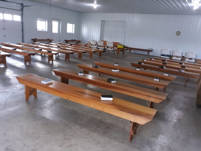 Church benches fill the Eicher family pole barn for church services they hosted.