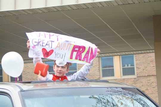 Friends and family of Hilltop resident Fran Davis held a parade outside the nursing home in honor of her 88th birthday on May 8, 2020. They held up posters and honked their hornes as they drove outside her window at the entrance of the nursing home.