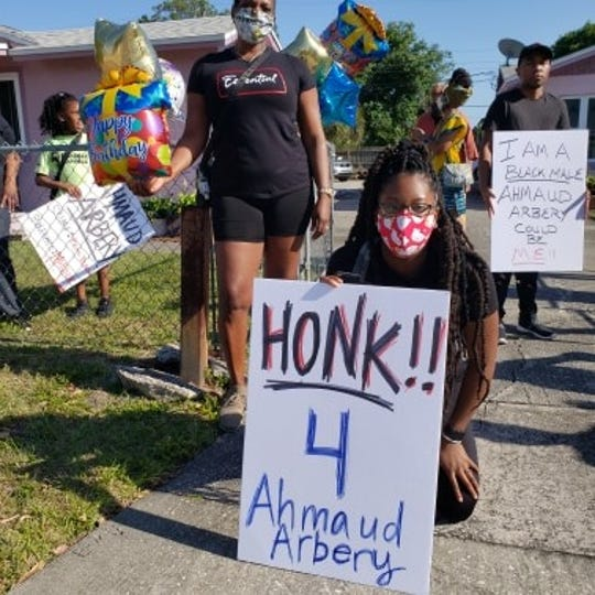 Marchers walk in Cocoa, callng for justice in the shooting death of Georgia resident Ahmaud Arbery.