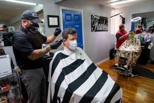 Flawless Barber Shop reopens for business on Friday, May 8, 2020 as part of Texas Gov. Greg Abbott's plan to reopen after coronavirus closures.