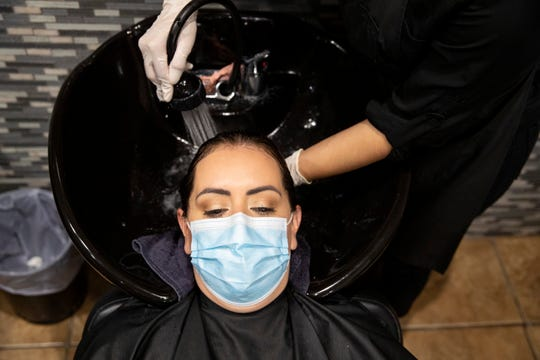 Angela Hernandez has her hair watched at Kosmo Salon on Friday, May 8, 2020. Barbershops and nail salons reopened on Friday, May 8, 2020 as part of Texas Gov. Greg Abbott's plan to reopen after coronavirus closures.