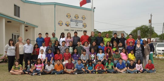 Evans Elementary fifth-graders in 2012-13 are pictured with principal Bruce Wilson, at the far right in the back row with a blue shirt. Wilson would go on to become principal of Miller High School, where some of the Evans students are now 12th-graders.