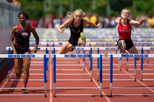 Cinnaminson senior Meredith Updike, center, has won four sectional titles and three state championships during her track career.