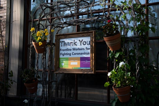 A sign thanking frontline workers is displayed outside Villa Barone, one of Collingswood's longest-established restaurants. The Italian restaurant and pizzeria has remained open for takeout.