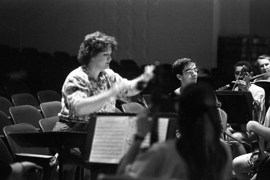 "Donna Leedy conducts the orchestra for Chillicothe High School's production of ""Meet Me in St. Louis"" in 1995."