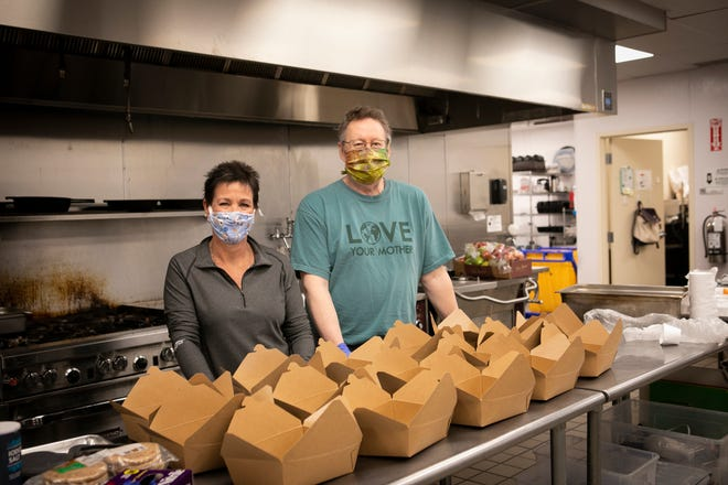 Karen Murphy, of Cleves, and Steve Smith, of Hartwell, are volunteers with St. Francis Seraph Ministries and have both stepped up to volunteer five days out of the week to help with a growing need.
