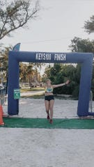 Rachel Belmont finishes an ultramarathon in Flordia in 2019