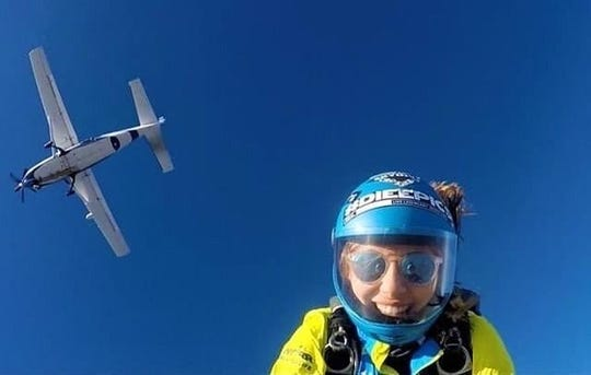 Rachel Belmont, who is running 100 miles on a treadmill to raise money for PPE, enjoys skydiving