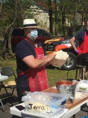 Assemblyman Joe Danielsen making homemade, which he donated along with protective face masks to families at the Franklin Township Food Pantry.