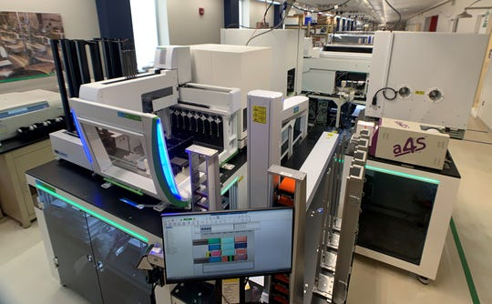 This fully automated nucleic acid extraction workstation at Rutgers' RUCDR Infinite Biologics can process up to 10,000 saliva samples per day for SARS-CoV-2 coronavirus testing.