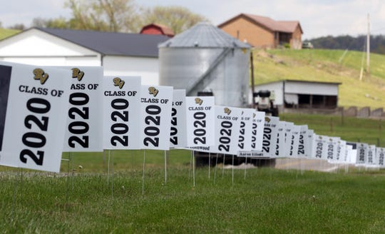 Senior signs line Ohio 60 beside River View High School in Warsaw on Thursday. When students graduate, they will take their sign for their front yard.