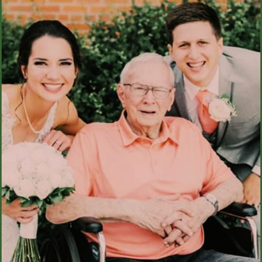 Ed Brezina of Washington County poses with his granddaughter, Demi, and her new husband Kirby Shelter. At age 94, Brezina was diagnosed with COVID-19 last month but is now free of symptoms.