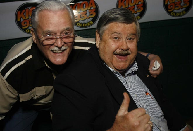 "Doug MacKinnon, left, one of the original KIOA ""Good Guys,"" is pictured with legendary Des Moines radio personality Dic Youngs in 2003 during Youngs' retirement party at the Val Air Ballroom."