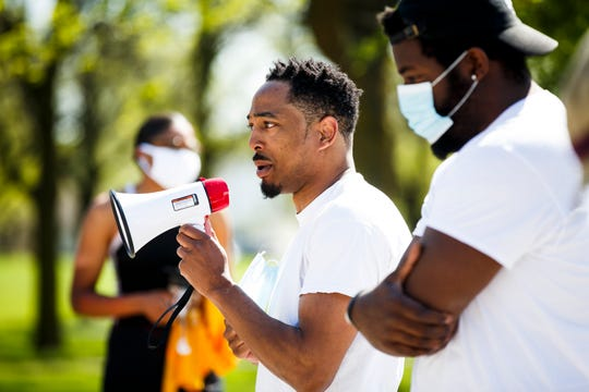 Organizer Kameron Middlebrooks addresses participants before they set off on the #RunwithMaud run on Friday, May 8, 2020. The national running tribute is in honor of Ahmaud Arbery of Georgia. Two white men are accused of fatally shooting him while he was on a run.