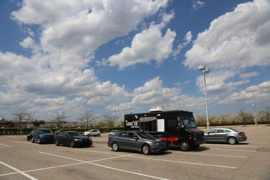 The drive-through line at the Lobster Food Truck in the parking lot of the Home Depot in Troy on May 7, 2020. To survive a summer without events -- the lifeblood of food trucks -- The Lobster Truck sets up for drive-through service in parking lots across metro Detroit.