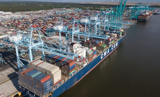 In this May 10, 2019, file photop, container ship is unloaded at the Virginia International Gateway terminal in Norfolk, Va.