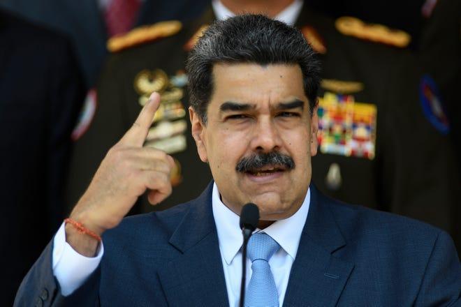 FILE - In this March 12, 2020 file photo, Venezuelan President Nicolas Maduro givesa press conference at the Miraflores presidential palace in Caracas, Venezuela.