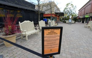 The Mall at Partridge Creek, on Hall Rd. in Clinton Twp., displays signs that hours are temporarily suspended, Friday afternoon, May 8, 2020, as per the governor's executive orders due to COVID-19. The mall's owner recently defaulted on a $725 million mortgage.