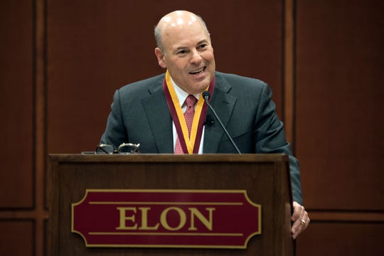 In this March 1, 2017 photo, Elon Trustee Louis DeJoy is honored with Elon's Medal for Entrepreneurial Leadership in Elon. N.C.