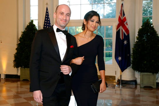 In this Sept. 20, 2019, file photo, President Donald Trump's White House Senior Adviser Stephen Miller, left, and Katie Waldman arrive for a state dinner at the White House in Washington.