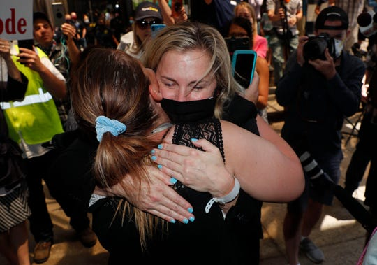 Salon owner Shelley Luther hugs a supporter after she was released Thursday from jail in Dallas. Luther was jailed for refusing to keep her business closed amid concerns of the spread of COVID-19.
