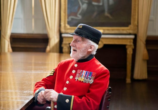 In this image taken on April 29, 2020 World War II veteran Bob Sullivan poses for a photo at the Royal Hospital Chelsea in London.