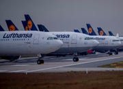 Aircrafts of German Lufthansa airline are parked on a runway at the airport in Frankfurt, Germany, Monday, May 4, 2020. Lufthansa is in negotiations with the German government about financial aid.