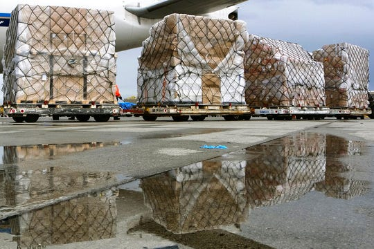 In this April 10, 2020, file photo, pallets of medical personal protective equipment are unloaded from a Chinese cargo plane at the Los Angeles International airport.