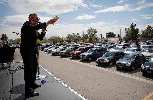 Pastor Paul Marc Goulet speaks to people in their cars at an Easter drive-in service at the International Church of Las Vegas, in this April 12, 2020, file photo in Las Vegas. The church held the service where worshipers stayed in their cars due to the coronavirus outbreak.