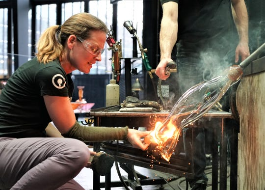 Glass artist Helen Tegeler holds a live demonstration of glass blowing at the Corning Museum of Glass. Like other tourist attractions, the museum has been closed due to the coronavirus pandemic