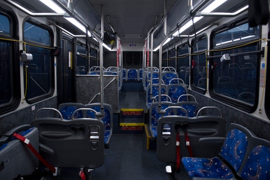 """A METS bus sits empty at the downtown terminal early Thursday morning, April 16, 2020. The amount of riders allowed on the bus has been reduced to nine due to Indiana's """"Stay-at-Home"""" executive order from Gov. Eric Holcomb to help stop the spread of COVID-19."""