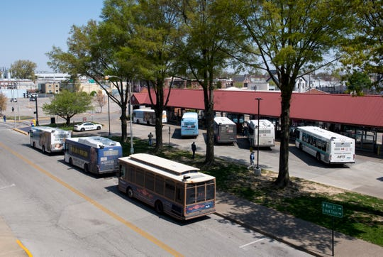 """METS buses pick up passengers at the downtown terminal Thursday afternoon, April 16, 2020. The amount of riders allowed on the bus has been reduced to nine due to Indiana's """"Stay-at-Home"""" executive order from Gov. Eric Holcomb due to the spread of COVID-19."""