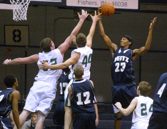Daimion Garrett of Reitz pulls down a rebound over Forest Park's Clint Hopf, left, and Brandon Schaefer during the Super Hoops Classic at Hinkle Fieldhouse in Indianapolis on Saturday, December 30, 2006. Reitz won the game 74-72 in overtime.