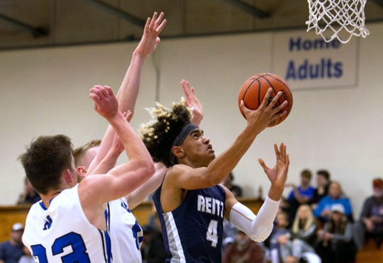 Reitz's Khristian Lander (4) shoots around Memorial's defense in the first round of the SIAC Tournament March 23, 2019.