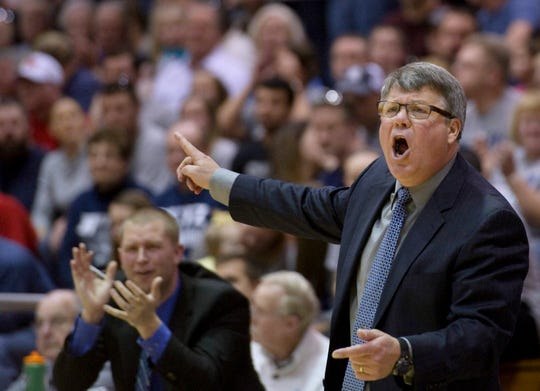 Reitz head coach Michael Adams calls out instruction to his Panthers as they take on the Richmond Red Devils in their semi-state game at Seymour High School Saturday afternoon, March 21, 2015. The Reitz Panthers beat the Richmond Red Devils 92-75 to advance to the state championship game next Saturday in Indianapolis.