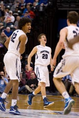 Reitz's Dru Smith (12), Alex Stein (20) and Jacob Norman (22) get back on defense after growing their lead against the Homestead Spartans in the Class 4A state championship game at Bankers Life Fieldhouse in Indianapolis, Ind., Saturday night, March 28, 2015.