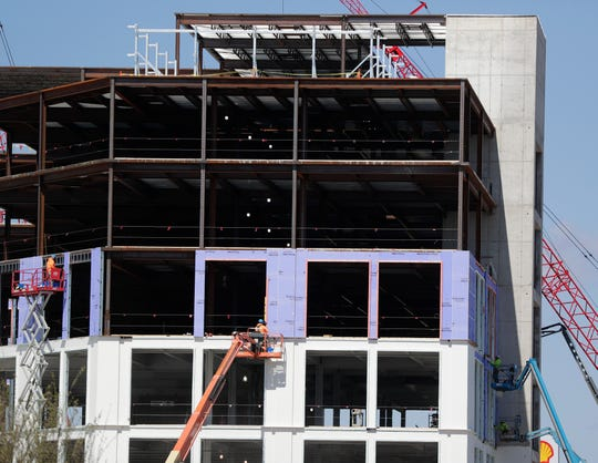 Work continues on Titletown District office building on Lombardi Avenue. The Green Bay Packers own the district.