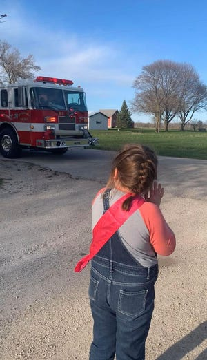 Sturgeon Bay 7-year-old Bree Greninger watched a parade of first responders gathered just for her golden birthday on May 7.