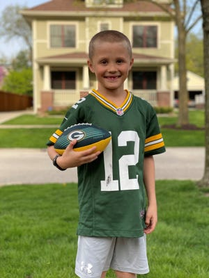 Seven-year-old Merritt Follstad is a proud Green Bay Packers and Aaron Rodgers fan living in Illinois, and he has the first-grade homework assignment to prove it.