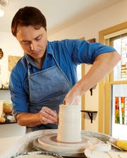 Chad Luberger of Plum Bottom Gallery in Egg Harbor works at his potter's wheel. Luberger's gallery is ramping up its online presence and hopes to increase online sales of its art while under closure because of the COVID-19 crisis.