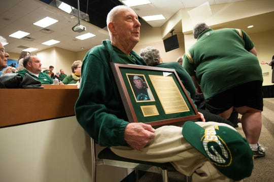 Ed Fritsch holds his plaque after being inducted into the Green Bay Packers Fan Hall of Fame in 2013.